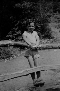 1934 Leaning on a fence