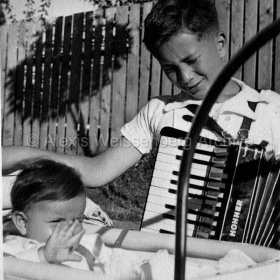 With his accordion